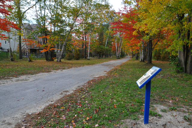 Road Behind Houses with Sign - Stonebridge